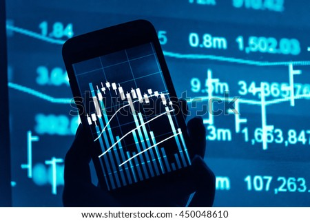 Working with digital tablet computer and smart phone with digital business strategy layer effect and the digital chart. Blue Tone. - stock photo