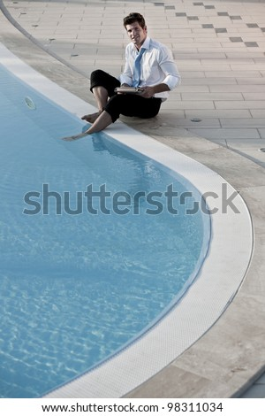 Working with feet in the pool - stock photo