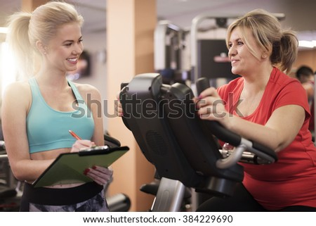 Working with personal trainer always gives good results - stock photo