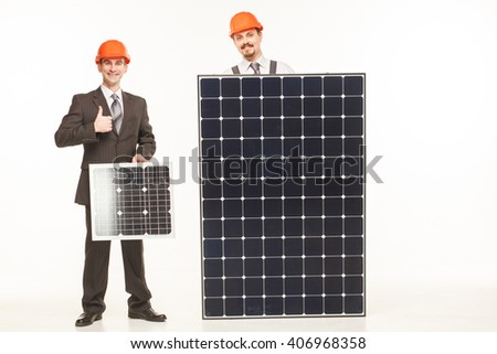 working with solar panels smiling studio standing - stock photo