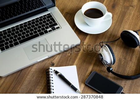 Working with the laptop, taking notes and drinking a coffee