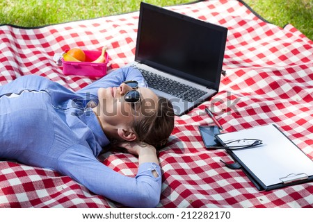 Working woman resting in a garden, horizontal - stock photo