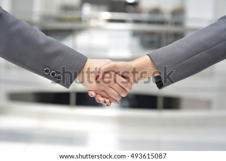 Working women shaking hands,business and office concept