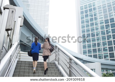 Working women walk the business district - stock photo