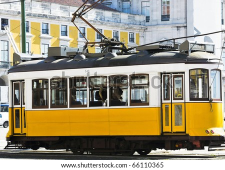 working yellow tramcar in Lisbon, Portugal