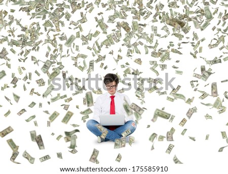 Working young man and dollar rain  - stock photo