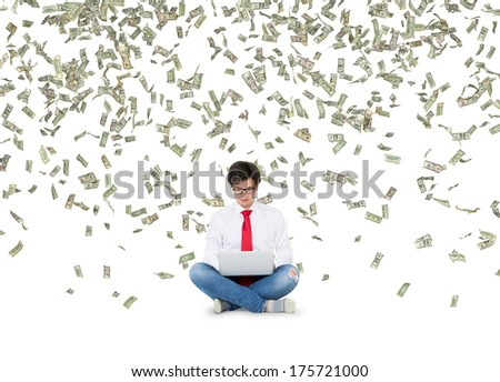 Working young man and dollars rain  - stock photo