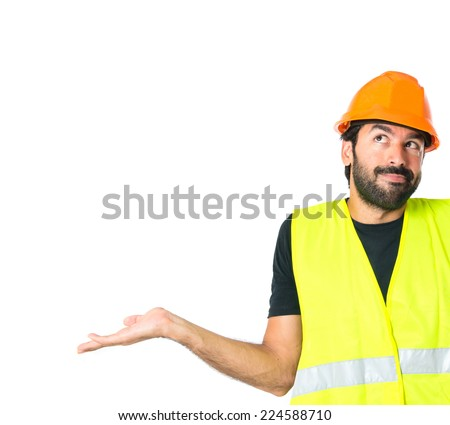 Workman having doubts over isolated white background - stock photo