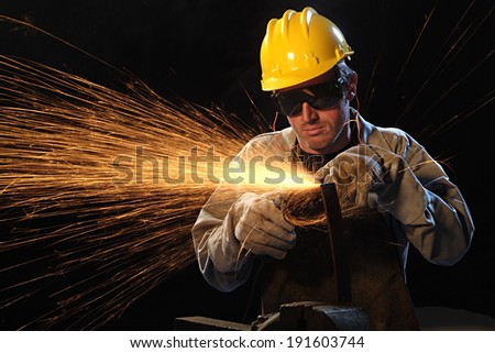 Workman in black background with sparkle - stock photo