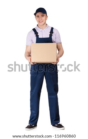 Workman in overalls and blue peaked cap keeps a cardboard box, isolated on white. Transportation service