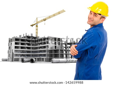 Workman in overalls and helmet by a construction site and blueprints - stock photo