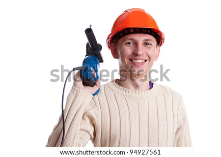 Workman in red helmet with drill