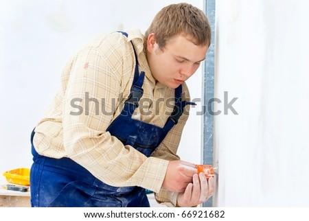 workman installing power socket - stock photo