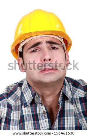 workman making grimace - stock photo