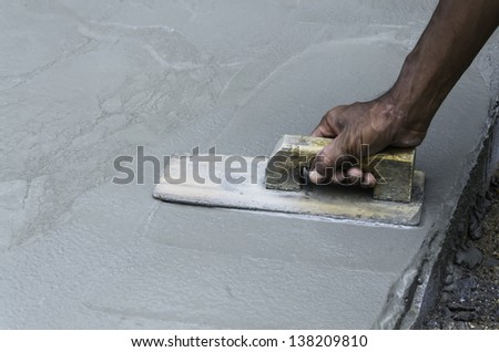 workman plaster on the concrete - stock photo
