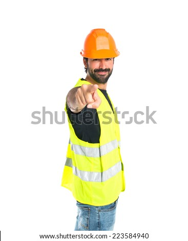 Workman pointing to the front over white background