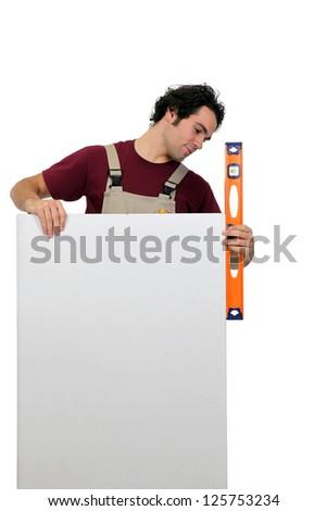 Workman using a spirit level - stock photo