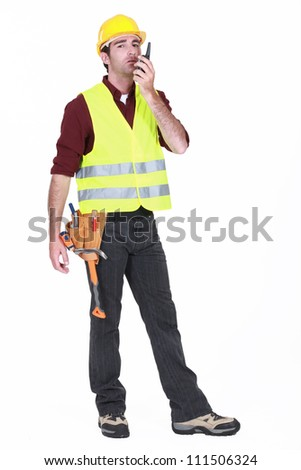 Workman using walkie-talkie on white background - stock photo
