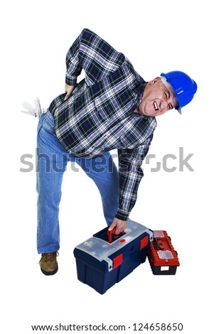 Workman with backache lifting the toolbox - stock photo