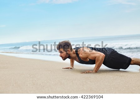 Workout Exercise. Closeup Of Healthy Handsome Active Man With Fit Muscular Body Doing Push Ups Exercises. Sporty Athletic Male Exercising At Beach, Training Outdoor. Sports And Fitness Concept - stock photo