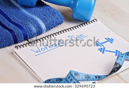 Workout plan,dumbbell and towel . Woman, fitness, sport concept background