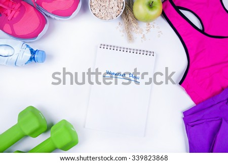 Workout plan with fitness food and equipment on white, top view - stock photo