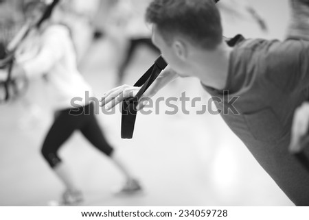 Workout with resistance band, monochrome  - stock photo