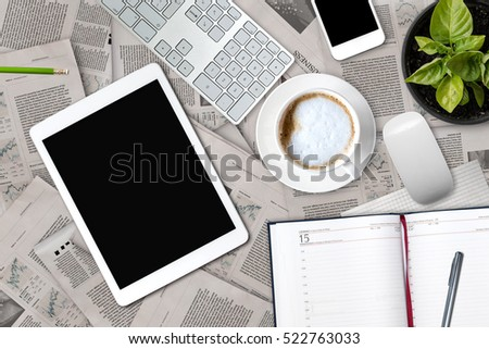 Workplace businessman. Newspapers, coffee and office equipment lie flat.