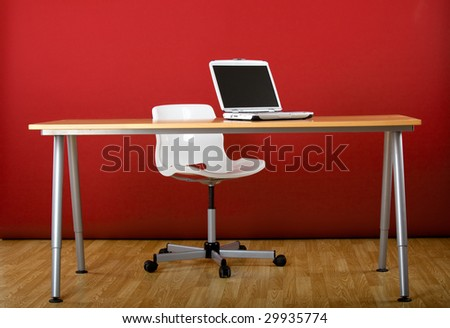 Workplace empty of people with a laptop over the desk - stock photo