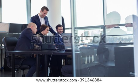 Workplace in modern office with business people brainstorming. Businessman working on laptop during the meeting. - stock photo