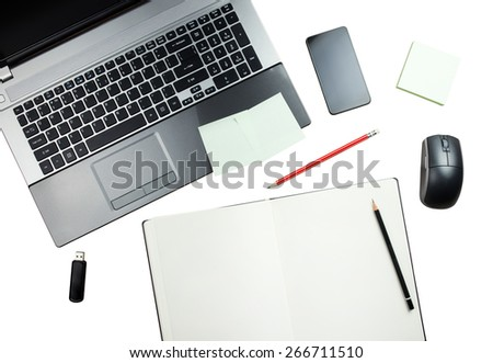 Workplace, laptop and notepad with pencils isolated on white background - stock photo