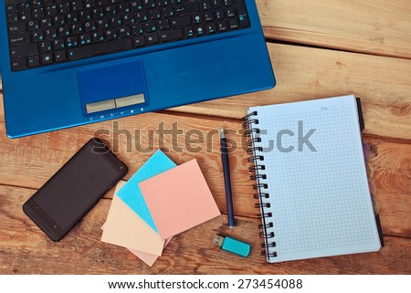 Workplace, laptop  on wooden table - stock photo
