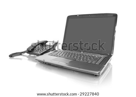 workplace. laptop with telephone isolated on white