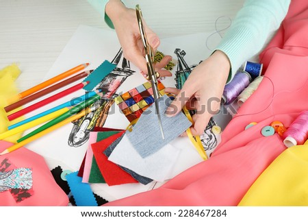 Workplace of designer clothing close-up - stock photo