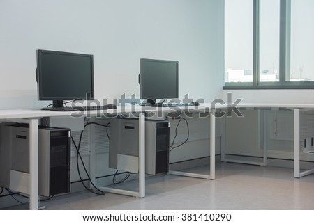 workplace room with computers - stock photo