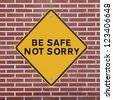 Workplace safety reminder on a red brick wall background - stock photo