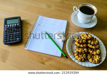 workplace, study place with calculator, workbook, cup of coffee and cookies - stock photo - stock photo