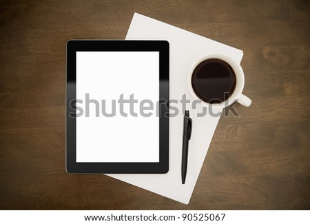 Workplace with blank digital tablet, paper, pen and cup of coffee on work table. Above view shot. - stock photo