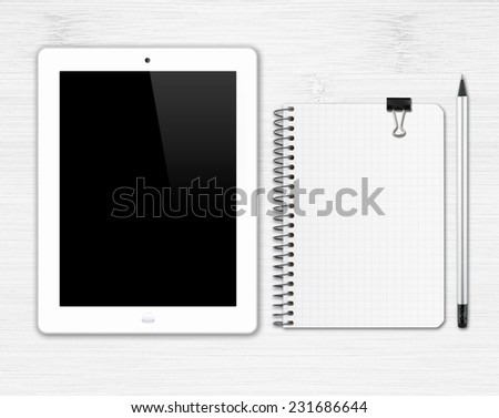 Workplace with digital tablet, notepad and pencil in black and white tones - stock photo