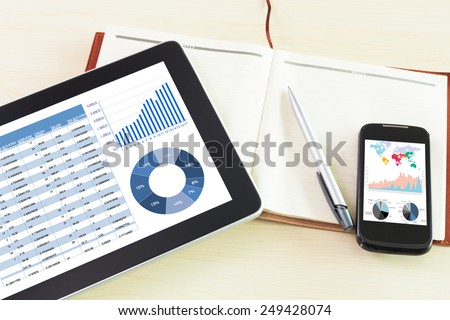 Workplace with digital tablet, paper, pen,smartphone. Above view shot. - stock photo