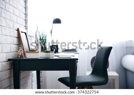 Workplace with laptop on table at home - stock photo