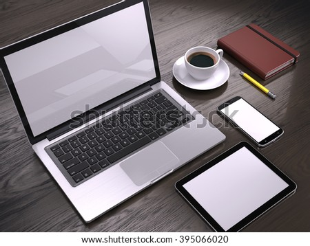 Workplace with Laptop, Tablet PC and smartphone with blank screens on table - stock photo