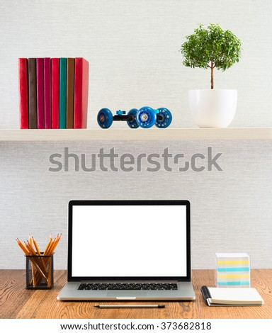 Workplace with modern accessories. Laptop on a table with blank screen.