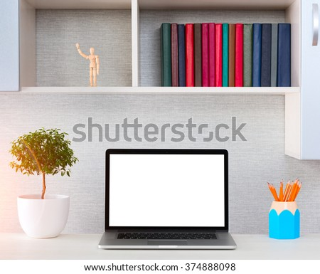 Workplace with modern accessories. Laptop on a table with blank screen - stock photo