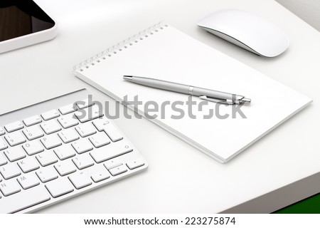 Workplace with notepad and keyboard, mouse - stock photo