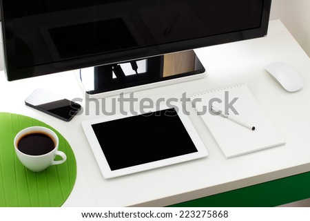 Workplace with notepad, coffee and keyboard, mobile - stock photo