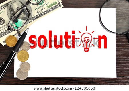 workplace with solution on paper - stock photo