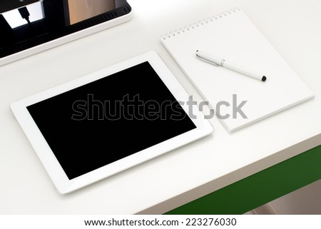 Workplace with tablet and keyboard, pen - stock photo