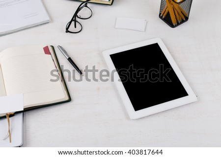 workplace with white tablet computer with blank screen, top view - stock photo