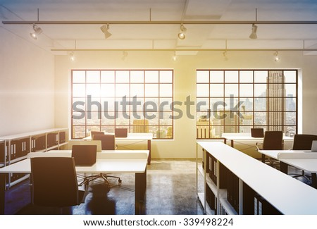 Workplaces in a bright modern loft open space office. Tables equipped with laptops; corporate documents' shelves. New York in the panoramic windows. 3D rendering. Toned image. - stock photo
